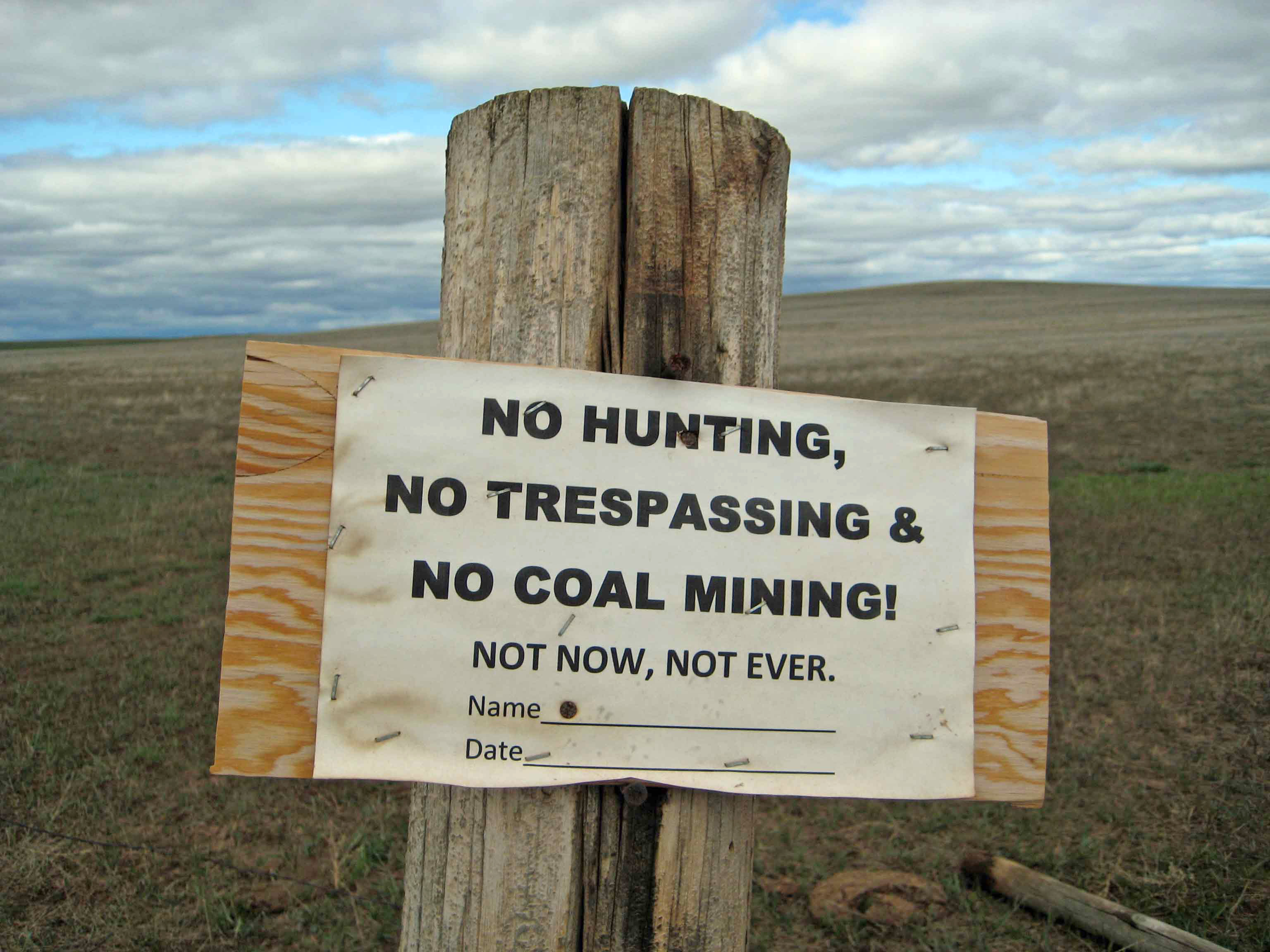 No coal mining sign