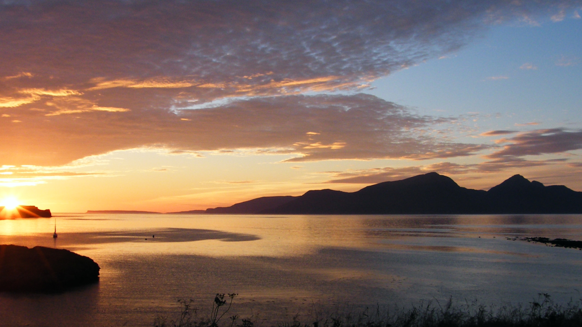 Sunset over Horse Island, Canna and Rùm. Photo: Chris Booth (CC BY-SA 2.0)