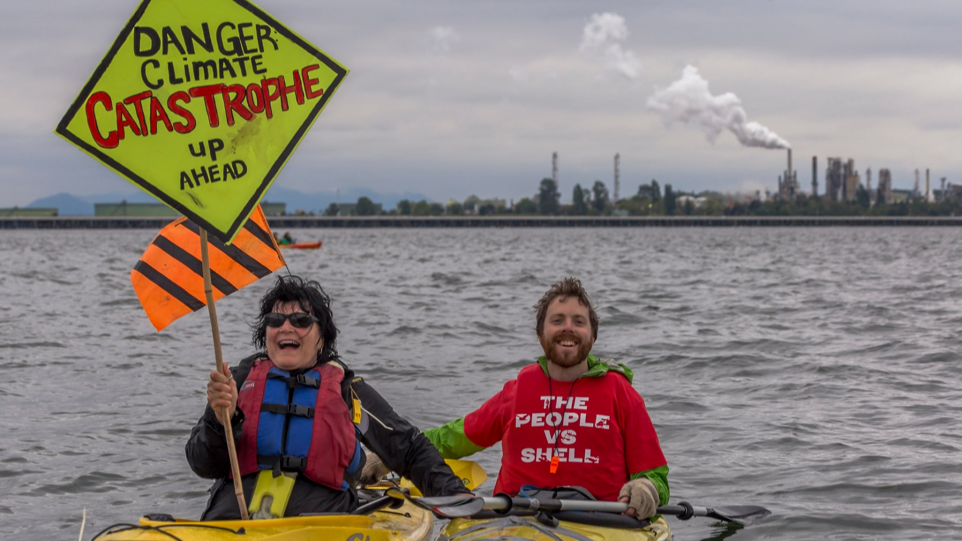 protesters in kayaks