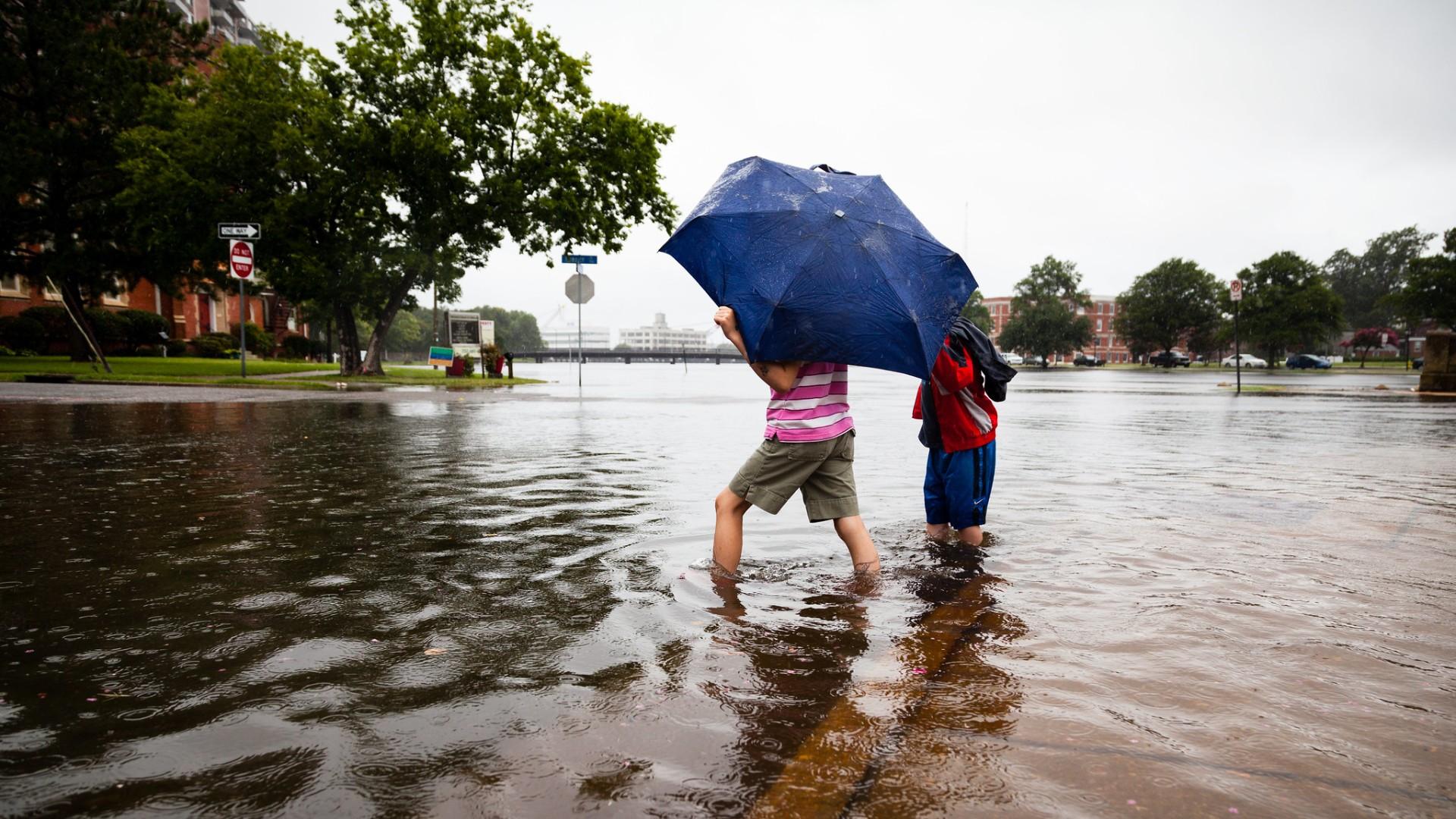 People on flooded street