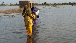 Family crosses flooded street