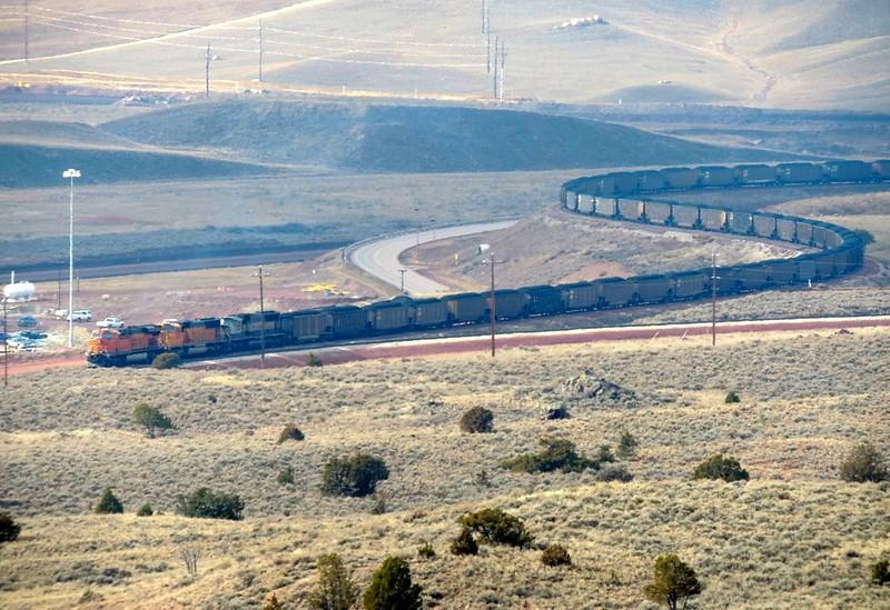 train snaking through plains