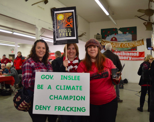 activists holding sign