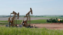 two pumpjacks with flare