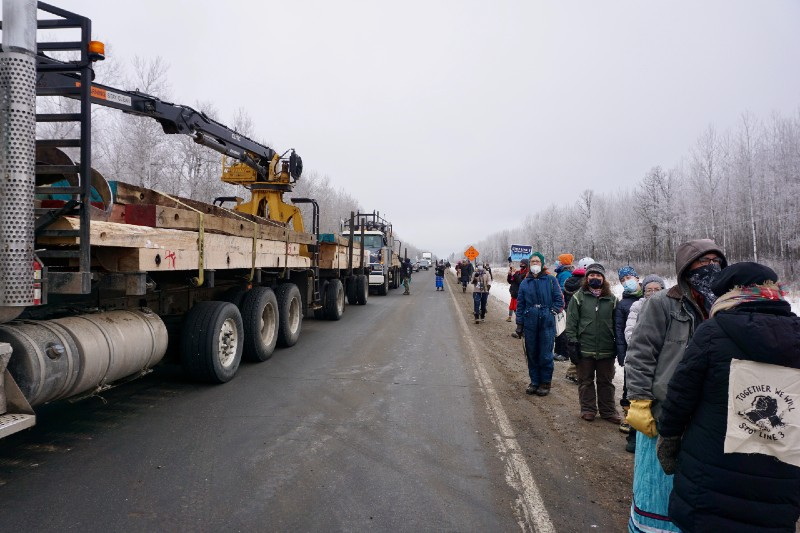 line of protesters and trucks